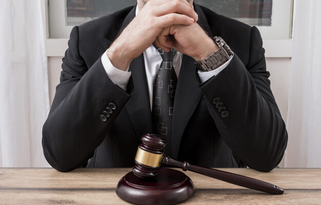 lawyer-with-gavel-hammer_23-2147984051